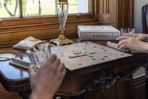 Play scrabble in the study